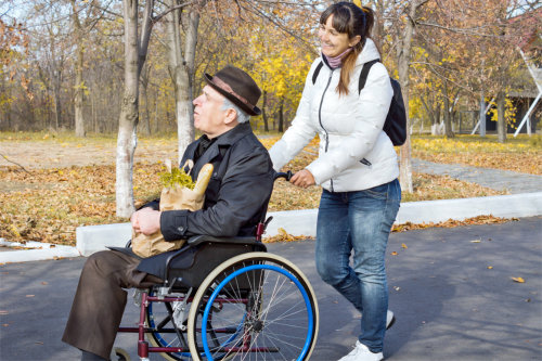 The caregiver and the patient strolling around