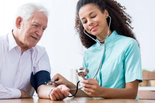 Staff taking blood pressure from the patient