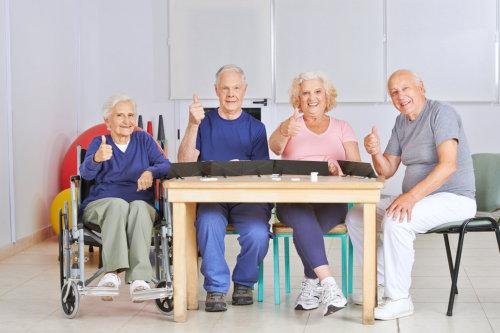 Group of elderly raising their thumb finger