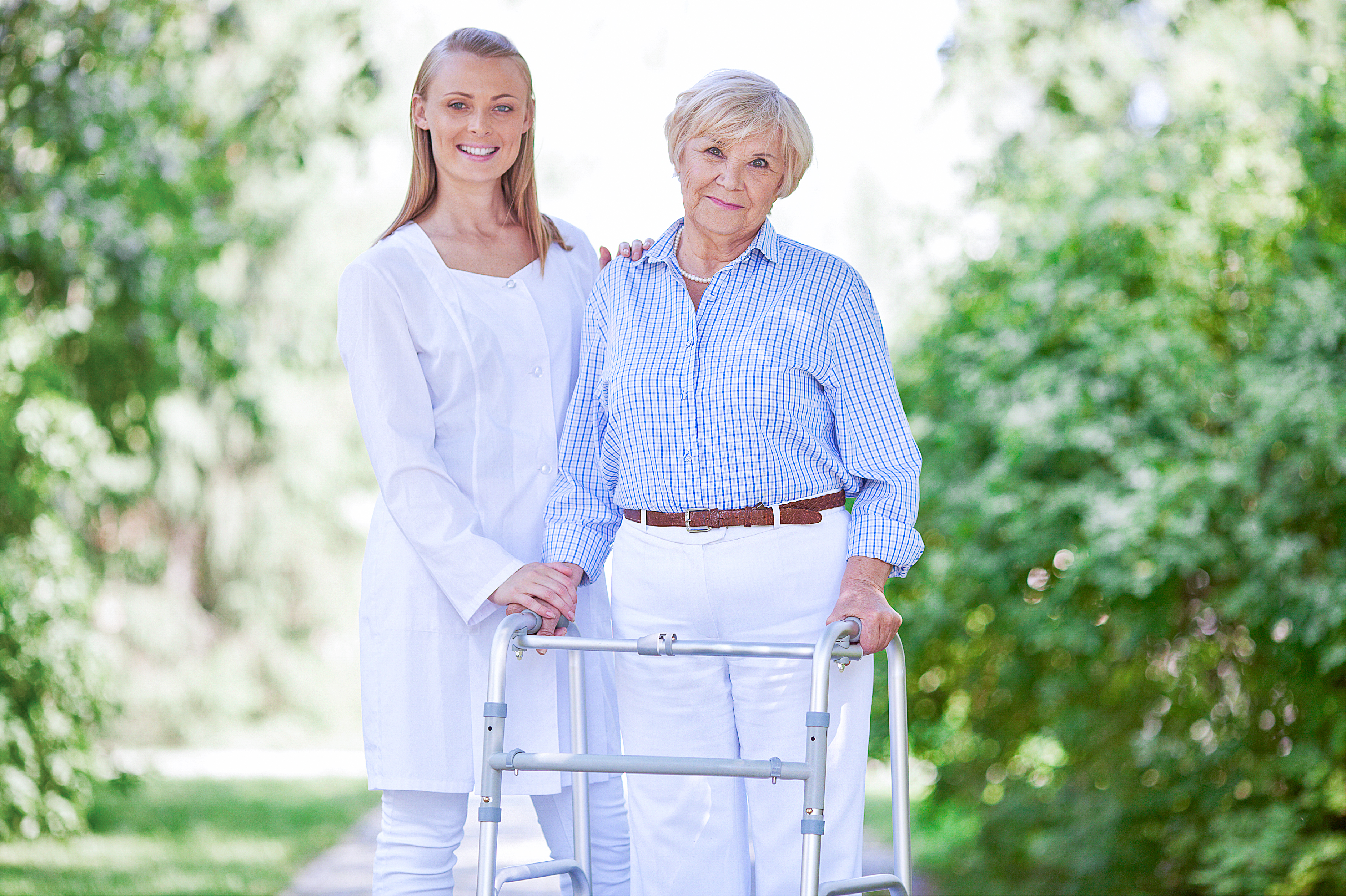 The caregiver and the patient standing