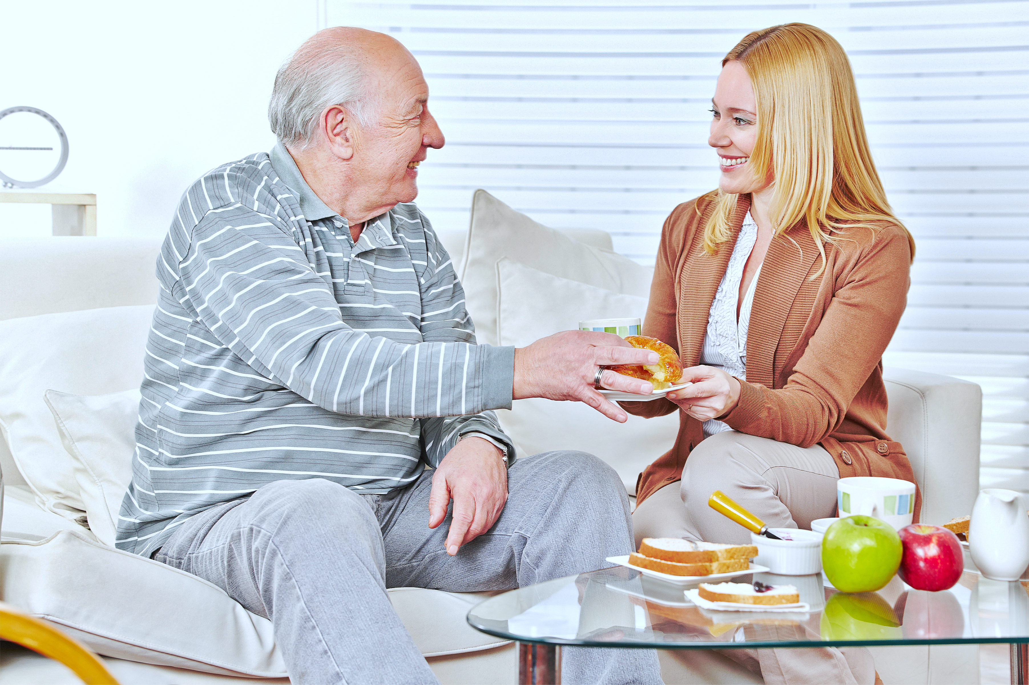 A caregiver giving some food to the patient